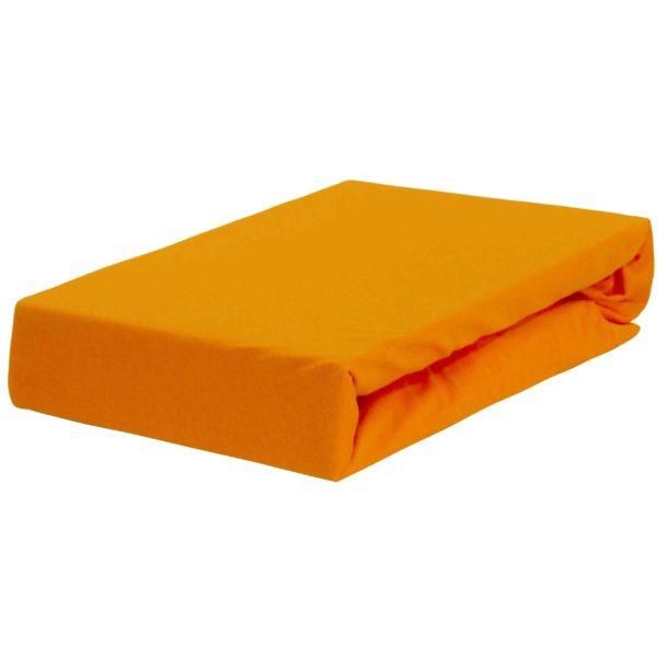 Prześcieradło jersey w zgaszonej pomarańczy.